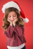 Sad little girl in santa hat Stock Photos
