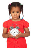 Sad little girl with a silvered clock Royalty Free Stock Photography