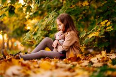 Free Sad Little Girl Sitting On Ground In Fallen Leaves. Children`s Resentment Stock Photos - 190816163