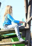 Sad little girl on a slide Stock Images