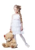 Sad little girl with soft toy Stock Image