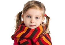 Sad  little girl in a striped scarf Stock Photos