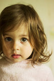 Sad little girl thinking. Cute sad little girl thinking Stock Image