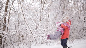 Sad little girl. The two sisters find each other in winter forest and happy stock footage