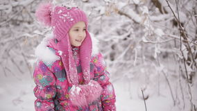Sad little girl. The two sisters find each other in winter forest and happy stock video footage