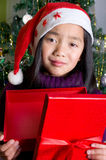 Sad little girl under the Christmas tree Stock Images