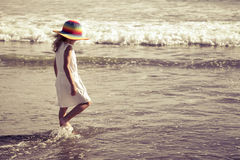 Sad little girl walking at the beach Royalty Free Stock Photography