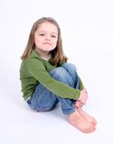 Sad little girl on white stock image