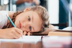 sad little girl writing stock photos