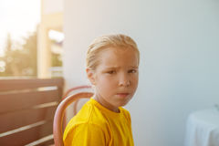 Sad little girl in yellow blouse Stock Photography