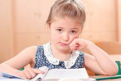 Sad little reading girl Royalty Free Stock Image