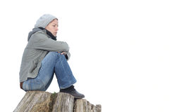 Sad and lonely. Woman sitting on a tree stub Royalty Free Stock Images
