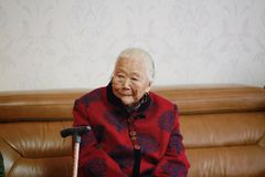 Sad and lonely Asian Chinese 90s old woman. Sad and lonely Asian Chinese old woman, 93 years old, up to 90s , silvery hair, golden earing on her ear Royalty Free Stock Photography