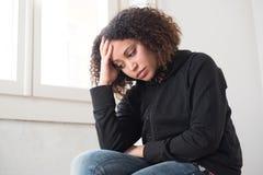 Sad and lonely black girl feeling depressed Royalty Free Stock Photo