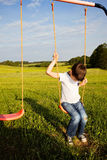 Sad lonely boy sitting on swing. Alone Royalty Free Stock Photos