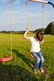 Sad lonely boy sitting on swing. Alone Stock Photos
