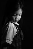 Sad and Lonely Child, Asian, in Black and White. Black and white portrait of sad and lonely Asian child Royalty Free Stock Photography