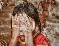 Sad lonely child. Sad crying lonely child. Photos in a grunge style Royalty Free Stock Images