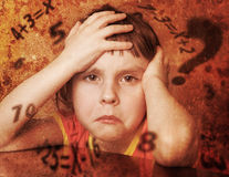 Sad lonely child. Lonely child solves problems. Photos in a grunge style Royalty Free Stock Images