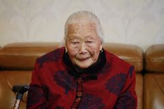 Sad and lonely elderly Asian Chinese 90s old woman portrait. Happy Asian Chinese old woman, 93 years old, up to 90s , silvery hair, golden earing on her ear Royalty Free Stock Photography