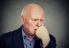Sad lonely elderly man feeling lonely Royalty Free Stock Photo