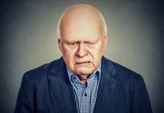 Sad lonely elderly man feeling lonely Stock Photography