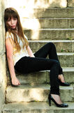 Sad lonely girl. Sitting on the stairs Stock Photography
