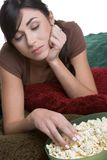 Sad Lonely Girl. Eating popcorn Royalty Free Stock Photography