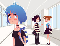 Sad lonely girl looking at two school friends. Stock Photos