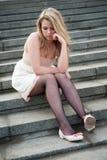 Sad lonely girl sitting Stock Image