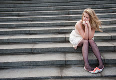 Sad Lonely Girl Sitting Stock Photo