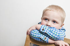 Sad and lonely little boy. Retro style portrait of a little boy with a sad and lonely look on his face Stock Image