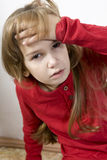 Sad and lonely little sick girl. In red Stock Images