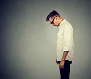 Sad lonely man looking down has no energy motivation depressed. Side profile sad lonely young man looking down has no energy motivation in life depressed Stock Photos