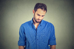 Sad lonely man looking down has no energy motivation in life depressed Royalty Free Stock Images
