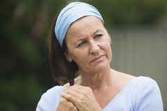 Sad lonely mature woman in grief and depression Stock Photography
