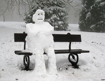 Sad Lonely Snowman seated alone Royalty Free Stock Image