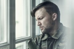Sad and lonely soldier in depression after war with emotional problem royalty free stock image