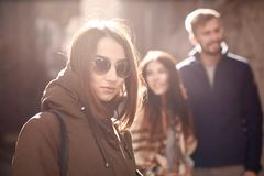 Sad lonely woman in black sunglasses on the happy couple background stock images