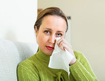 Sad and lonely woman at home Royalty Free Stock Images