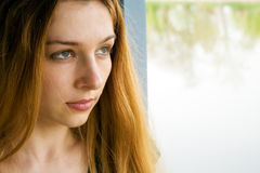 Sad and lonely young woman Royalty Free Stock Photos
