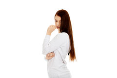 Sad lonely young woman biting her nail Royalty Free Stock Photography