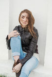 Sad long-haired girl in leather jacket with a Royalty Free Stock Images