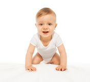 Sad looking baby crawling and wearing white body