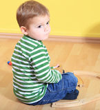 Sad looking boy in kindergarten stock photos