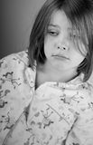 Sad Looking Child in Pyjamas Royalty Free Stock Images