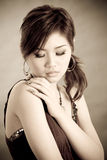 Sad looking girl. Sentimental, sad looking young lady in warm tone color Royalty Free Stock Image