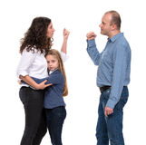 Sad looking girl with her fighting parents Royalty Free Stock Photos
