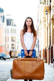 Sad looking girl with luggage Royalty Free Stock Images