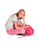 Sad looking girl with pink backpack. Royalty Free Stock Images